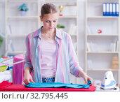Купить «Happy housewife doing ironing at home», фото № 32795445, снято 28 июня 2017 г. (c) Elnur / Фотобанк Лори