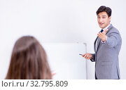 Купить «The business presentation in the office with man and woman», фото № 32795809, снято 7 августа 2017 г. (c) Elnur / Фотобанк Лори
