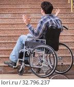 Купить «Disabled man on wheelchair having trouble with stairs», фото № 32796237, снято 14 апреля 2017 г. (c) Elnur / Фотобанк Лори