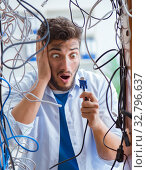 Купить «Electrician trying to untangle wires in repair concept», фото № 32796637, снято 7 июля 2017 г. (c) Elnur / Фотобанк Лори