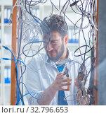 Купить «Electrician trying to untangle wires in repair concept», фото № 32796653, снято 7 июля 2017 г. (c) Elnur / Фотобанк Лори