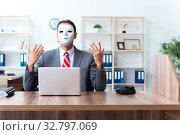 Купить «Businessman wearing mask in hypocrisy concept», фото № 32797069, снято 24 июня 2019 г. (c) Elnur / Фотобанк Лори