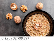 Delicious walnuts on grey rustic background. Стоковое фото, фотограф Zoonar.com/Tomas Anderson / easy Fotostock / Фотобанк Лори