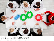 Business problem solution, mechanism of business, teamwork concept, business team sitting around white table with cogs. Стоковое фото, фотограф Zoonar.com/Tatiana Badaeva / easy Fotostock / Фотобанк Лори