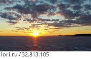 Купить «Flying over frozen sea at amazing sunset with red Sun and clouds», видеоролик № 32813105, снято 21 декабря 2019 г. (c) Serg Zastavkin / Фотобанк Лори