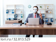 Купить «Businessman wearing mask in hypocrisy concept», фото № 32813529, снято 24 июня 2019 г. (c) Elnur / Фотобанк Лори