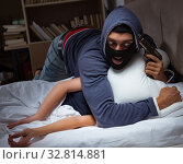 Купить «Burglar breaking into house at night to bedroom with sleeping wo», фото № 32814881, снято 9 августа 2017 г. (c) Elnur / Фотобанк Лори