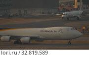 Купить «Airfreighter taxiing after landing», видеоролик № 32819589, снято 7 ноября 2019 г. (c) Игорь Жоров / Фотобанк Лори