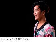 Купить «Studio shot of young handsome Asian man against black background», фото № 32822825, снято 27 мая 2020 г. (c) easy Fotostock / Фотобанк Лори