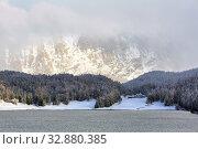 Купить «High Alpine resort town St. Moritz in winter. View of the Lake St. Moritz. District of Maloja in the Swiss canton of Graubuenden, Switzerland.», фото № 32880385, снято 8 ноября 2019 г. (c) Bala-Kate / Фотобанк Лори