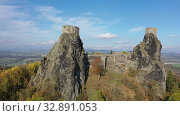 Купить «Above view of medieval castle Trosky. Czech Republic», видеоролик № 32891053, снято 18 октября 2019 г. (c) Яков Филимонов / Фотобанк Лори