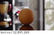 Купить «A closeup of a wet orange spinning on a glossy surface», видеоролик № 32891269, снято 3 апреля 2020 г. (c) Данил Руденко / Фотобанк Лори