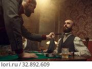 Купить «Poker player grabbed his opponent's tie, casino», фото № 32892609, снято 8 декабря 2019 г. (c) Tryapitsyn Sergiy / Фотобанк Лори