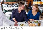 Купить «Friendly waiter serving tasty dishes», фото № 32892877, снято 26 октября 2018 г. (c) Яков Филимонов / Фотобанк Лори