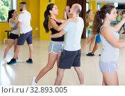 Young group of dancers are dancing waltz in pairs. Стоковое фото, фотограф Яков Филимонов / Фотобанк Лори