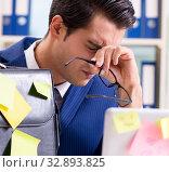 Купить «Businessman with reminder notes in multitasking concept», фото № 32893825, снято 26 сентября 2017 г. (c) Elnur / Фотобанк Лори