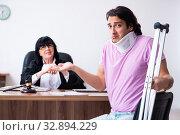 Купить «Disabled man consulting judge for damages litigation», фото № 32894229, снято 6 мая 2019 г. (c) Elnur / Фотобанк Лори