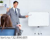 Купить «Business presentation in the office with man and woman», фото № 32894601, снято 7 августа 2017 г. (c) Elnur / Фотобанк Лори