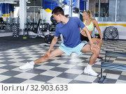 Couple stretching before workout at gym. Стоковое фото, фотограф Яков Филимонов / Фотобанк Лори