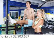 Купить «Man doing push-ups with trainer», фото № 32903637, снято 16 июля 2018 г. (c) Яков Филимонов / Фотобанк Лори