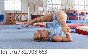 Купить «Sporty female gymnast in bodysuit during workout in sport gym», фото № 32903653, снято 18 июля 2018 г. (c) Яков Филимонов / Фотобанк Лори