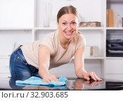Smiling woman wiping table. Стоковое фото, фотограф Яков Филимонов / Фотобанк Лори