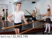 Young efficient dancer exercising in ballroom. Стоковое фото, фотограф Яков Филимонов / Фотобанк Лори