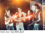 Купить «Portrait of the winners in the game laser tag», фото № 32905821, снято 22 февраля 2020 г. (c) Яков Филимонов / Фотобанк Лори