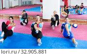 Купить «Women doing box exercises», фото № 32905881, снято 8 октября 2017 г. (c) Яков Филимонов / Фотобанк Лори