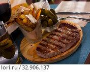 Купить «Beef entrecote with spices on a wooden round board», фото № 32906137, снято 31 марта 2020 г. (c) Яков Филимонов / Фотобанк Лори