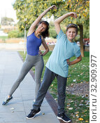 Купить «Mother and son stretching outdoors», фото № 32909977, снято 11 ноября 2018 г. (c) Яков Филимонов / Фотобанк Лори