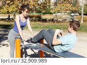Купить «Boy doing push-ups on sport bench», фото № 32909989, снято 11 ноября 2018 г. (c) Яков Филимонов / Фотобанк Лори