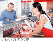 Купить «Young seller helping male choosing sausages», фото № 32910089, снято 22 июня 2018 г. (c) Яков Филимонов / Фотобанк Лори