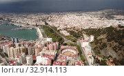 Купить «Panoramic view of Mediterranean coastal city of Malaga with harbor, Spain», видеоролик № 32914113, снято 18 апреля 2019 г. (c) Яков Филимонов / Фотобанк Лори
