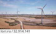 Купить «Aerial view of wind power plants near the town of La Muela, Spain», видеоролик № 32914141, снято 16 июня 2019 г. (c) Яков Филимонов / Фотобанк Лори