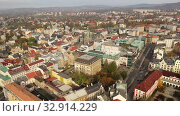 Купить «Aerial view of Liberec cityscape with buildings and streets, Czech Republic», видеоролик № 32914229, снято 19 октября 2019 г. (c) Яков Филимонов / Фотобанк Лори