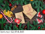 Купить «Three gifts in retro packaging on a wooden table close-up, objects Christmas concept», фото № 32914441, снято 30 декабря 2018 г. (c) Константин Лабунский / Фотобанк Лори