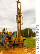Russia, Samara, September 2019: a special machine drills a well for water on a village street. Редакционное фото, фотограф Акиньшин Владимир / Фотобанк Лори