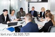 Купить «Multinational group of confident business partners discussing», фото № 32920721, снято 10 марта 2018 г. (c) Яков Филимонов / Фотобанк Лори