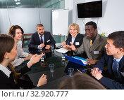 Купить «Business people of different nationalities developing strategy for teamwork», фото № 32920777, снято 12 февраля 2018 г. (c) Яков Филимонов / Фотобанк Лори