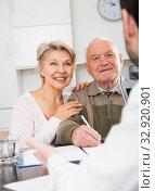 Купить «Old man and woman in social department», фото № 32920901, снято 3 августа 2020 г. (c) Яков Филимонов / Фотобанк Лори