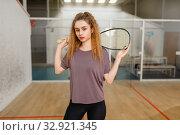 Female player holds squash racket and ball. Стоковое фото, фотограф Tryapitsyn Sergiy / Фотобанк Лори