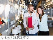 Купить «Smiling couple customers choosing bedside lamp in furniture store», фото № 32922013, снято 29 января 2018 г. (c) Яков Филимонов / Фотобанк Лори