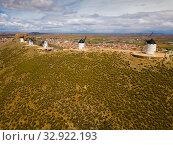 Купить «Aerial view of Wind mills at knolls at Consuegra, Toledo region», фото № 32922193, снято 23 апреля 2019 г. (c) Яков Филимонов / Фотобанк Лори