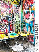 Купить «Painted chairs in front of grafitti covered wall, paris, ile de france, france», фото № 32924685, снято 17 февраля 2020 г. (c) age Fotostock / Фотобанк Лори