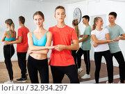 Купить «Teenage boys and girls training slow foxtrot», фото № 32934297, снято 27 мая 2020 г. (c) Яков Филимонов / Фотобанк Лори