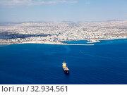 Купить «Aerial view at Larnaca city and Main Harbor in Cyprus island. Dry-cargo freighter coming from port», фото № 32934561, снято 18 сентября 2013 г. (c) Кекяляйнен Андрей / Фотобанк Лори