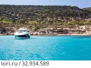 Купить «Luxury speedboat waving in blue lagoon of Mediterranean sea. Cyprus island with beautiful coastline, copyspace», фото № 32934589, снято 22 сентября 2013 г. (c) Кекяляйнен Андрей / Фотобанк Лори