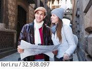 Купить «Man and woman with map and package looking attraction outdoors», фото № 32938097, снято 18 ноября 2017 г. (c) Яков Филимонов / Фотобанк Лори