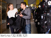 Купить «Woman seller is helping man choose new diving equipment in the store.», фото № 32938121, снято 25 января 2018 г. (c) Яков Филимонов / Фотобанк Лори